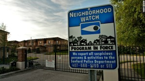 gated community with watch sign