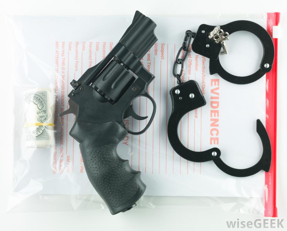 bag-labeled-evidence-with-gun-and-handcuffs