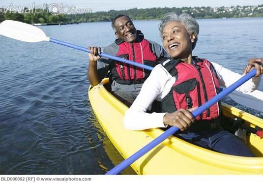 elderly_couple_sitting_together_in_a_kayak_on_a_lake_bld000092