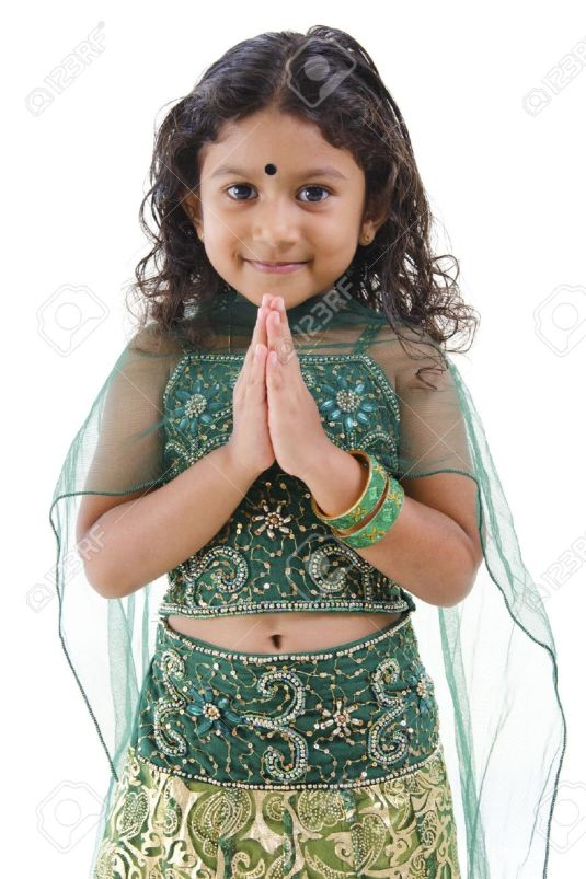 14159276-cute-little-indian-girl-in-a-greeting-pose-isolated-white-background