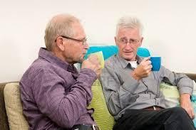 old men drinking coffee