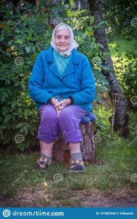 old-woman-sitting-log-very-caucasian-lady-senior-portrait-outdoors-wearing-blue-sweater-scarf-131962948